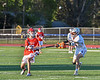 Baldwinsville Bees Trey Ordway (33) passing the ball against Liverpool Warriors Liam MacIntosh (7) in Section III Boys Lacrosse action at Liverpool High School Stadium in Liverpool, New York on Thursday, May 13, 2021. Baldwinsville won 17-3.