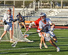 Liverpool Warriors Owen Atchie (9) with the ball against the Baldwinsville Bees in Section III Boys Lacrosse action at Liverpool High School Stadium in Liverpool, New York on Thursday, May 13, 2021. Baldwinsville won 17-3.