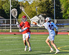 Baldwinsville Bees goalie Cooper Foote (5) passing the ball against the Liverpool Warriors in Section III Boys Lacrosse action at Liverpool High School Stadium in Liverpool, New York on Thursday, May 13, 2021. Baldwinsville won 17-3.
