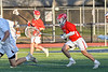 Baldwinsville Bees goalie Cooper Foote (5) running with the ball against the Liverpool Warriors in Section III Boys Lacrosse action at Liverpool High School Stadium in Liverpool, New York on Thursday, May 13, 2021. Baldwinsville won 17-3.