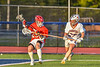 Baldwinsville Bees Colin Doyle (23) protecting the ball from Liverpool Warriors Gianpaul Cooper (27) in Section III Boys Lacrosse action at Liverpool High School Stadium in Liverpool, New York on Thursday, May 13, 2021. Baldwinsville won 17-3.