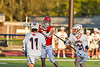 Baldwinsville Bees Caden Cox (4) being defended by Liverpool Warriors Dominick Osbeck (11) and Gavin Kenna (31) in Section III Boys Lacrosse action at Liverpool High School Stadium in Liverpool, New York on Thursday, May 13, 2021. Baldwinsville won 17-3.