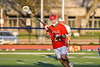 Baldwinsville Bees Brayden Penafeather-Stevenson (21) with the ball against the Liverpool Warriors in Section III Boys Lacrosse action at Liverpool High School Stadium in Liverpool, New York on Thursday, May 13, 2021. Baldwinsville won 17-3.