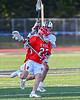 Baldwinsville Bees Colin Doyle (23) protecting the ball from Liverpool Warriors Dominick Osbeck (11) in Section III Boys Lacrosse action at Liverpool High School Stadium in Liverpool, New York on Thursday, May 13, 2021. Baldwinsville won 17-3.