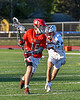 Baldwinsville Bees Lucas Hoskin (16) with the ball being defended by Liverpool Warriors Dominick Osbeck (11) in Section III Boys Lacrosse action at Liverpool High School Stadium in Liverpool, New York on Thursday, May 13, 2021. Baldwinsville won 17-3.