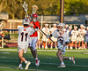 Baldwinsville Bees Caden Cox (4) passing the ball against Liverpool Warriors Dominick Osbeck (11) and Gavin Kenna (31) in Section III Boys Lacrosse action at Liverpool High School Stadium in Liverpool, New York on Thursday, May 13, 2021. Baldwinsville won 17-3.