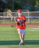 Baldwinsville Bees Trey Ordway (33) looking to make a play against the Liverpool Warriors in Section III Boys Lacrosse action at Liverpool High School Stadium in Liverpool, New York on Thursday, May 13, 2021. Baldwinsville won 17-3.