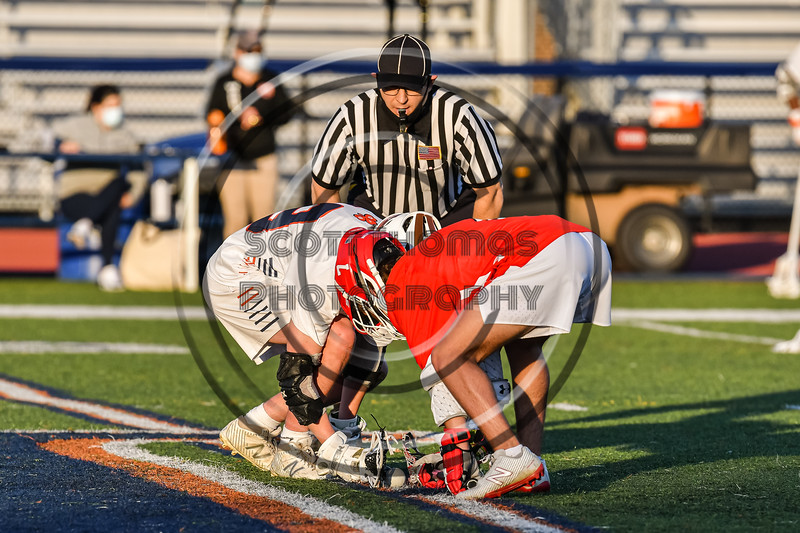 Baldwinsville Bees and Liverpool Warriors about to face-off in a Section III Boys Lacrosse game at Liverpool High School Stadium in Liverpool, New York on Thursday, May 13, 2021. Baldwinsville won 17-3.