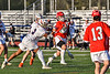 Baldwinsville Bees Michael Marsallo (29) avoiding Liverpool Warriors defenders to score a goal in Section III Boys Lacrosse action at Liverpool High School Stadium in Liverpool, New York on Thursday, May 13, 2021. Baldwinsville won 17-3.