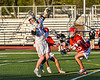 Baldwinsville Bees Trey Ordway (33) checking a Liverpool Warriors player with the ball in Section III Boys Lacrosse action at Liverpool High School Stadium in Liverpool, New York on Thursday, May 13, 2021. Baldwinsville won 17-3.