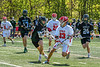 Baldwinsville Bees Trey Ordway (33) being defended by Marcellus Mustangs Ryan Moses (13) in Section III Boys Lacrosse action at the Pelcher-Arcaro Stadium in Baldwinsville, New York on Saturday, May 15, 2021. Baldwinsville won 17-4.