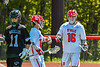 Baldwinsville Bees Keegan Lynch (13) congratulates Lucas Hoskin (16) on his goal against the Marcellus Mustangs in Section III Boys Lacrosse action at the Pelcher-Arcaro Stadium in Baldwinsville, New York on Saturday, May 15, 2021. Baldwinsville won 17-4.