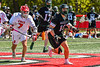 Marcellus Mustangs Matt Welch (10) wins a face-off against Baldwinsville Bees Jacob Czyz (7) in Section III Boys Lacrosse action at the Pelcher-Arcaro Stadium in Baldwinsville, New York on Saturday, May 15, 2021. Baldwinsville won 17-4.