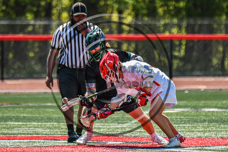 Baldwinsville Bees Jacob Czyz (7) facing off against Marcellus Mustangs Matt Welch (10) in Section III Boys Lacrosse action at the Pelcher-Arcaro Stadium in Baldwinsville, New York on Saturday, May 15, 2021. Baldwinsville won 17-4.