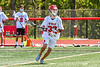 Baldwinsville Bees Trey Ordway (33) looking to make a play against the Marcellus Mustangs in Section III Boys Lacrosse action at the Pelcher-Arcaro Stadium in Baldwinsville, New York on Saturday, May 15, 2021. Baldwinsville won 17-4.