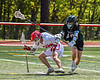 Baldwinsville Bees Keegan Lynch (13) beind defended by Marcellus Mustangs Jeffrey Lantry (19) in Section III Boys Lacrosse action at the Pelcher-Arcaro Stadium in Baldwinsville, New York on Saturday, May 15, 2021. Baldwinsville won 17-4.
