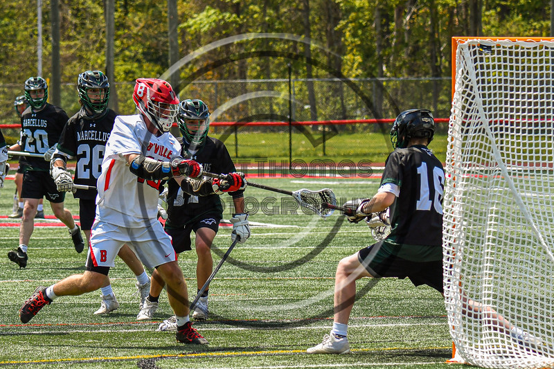 Baldwinsville Bees Lucas Hoskin (16) drives to the net and scores a goal against Marcellus Mustangs goalie Quenten Polkowski (16) in Section III Boys Lacrosse action at the Pelcher-Arcaro Stadium in Baldwinsville, New York on Saturday, May 15, 2021. Baldwinsville won 17-4.
