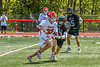 Baldwinsville Bees Trey Ordway (33) with the ball against Marcellus Mustangs Ryan Moses (13) in Section III Boys Lacrosse action at the Pelcher-Arcaro Stadium in Baldwinsville, New York on Saturday, May 15, 2021. Baldwinsville won 17-4.