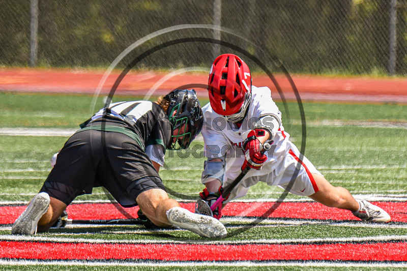 Baldwinsville Bees Jacob Czyz (7) faces off against Marcellus Mustangs Matt Welch (10) in Section III Boys Lacrosse action at the Pelcher-Arcaro Stadium in Baldwinsville, New York on Saturday, May 15, 2021. Baldwinsville won 17-4.
