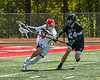 Baldwinsville Bees Michael Marsallo (29) making a run against Marcellus Mustangs Thomas Donahue III (24) in Section III Boys Lacrosse action at the Pelcher-Arcaro Stadium in Baldwinsville, New York on Saturday, May 15, 2021. Baldwinsville won 17-4.