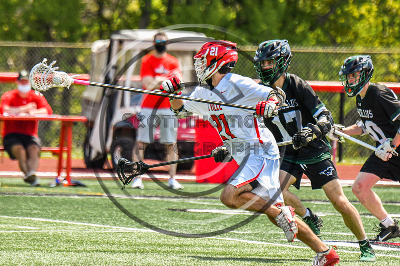Baldwinsville Bees Brayden Penafeather-Stevenson (21) running with the ball against the Marcellus Mustangs in Section III Boys Lacrosse action at the Pelcher-Arcaro Stadium in Baldwinsville, New York on Saturday, May 15, 2021. Baldwinsville won 17-4.