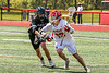 Baldwinsville Bees Keegan Lynch (13) protecing the ball from Marcellus Mustangs Luke Spitzer (11) in Section III Boys Lacrosse action at the Pelcher-Arcaro Stadium in Baldwinsville, New York on Saturday, May 15, 2021. Baldwinsville won 17-4.