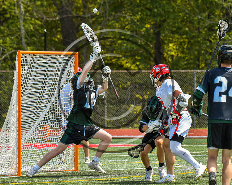 Marcellus Mustangs goalie Quenten Polkowski (16) makes a save against Baldwinsville Bees Michael Marsallo (29) in Section III Boys Lacrosse action at the Pelcher-Arcaro Stadium in Baldwinsville, New York on Saturday, May 15, 2021. Baldwinsville won 17-4.
