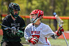 Baldwinsville Bees Ryan Hollenbeck (17) protecting the ball from a Marcellus Mustangs defender in Section III Boys Lacrosse action at the Pelcher-Arcaro Stadium in Baldwinsville, New York on Saturday, May 15, 2021. Baldwinsville won 17-4.
