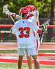 Baldwinsville Bees Keegan Lynch (13) congratulates Trey Ordway (33) on his goal against the Marcellus Mustangs in Section III Boys Lacrosse action at the Pelcher-Arcaro Stadium in Baldwinsville, New York on Saturday, May 15, 2021. Baldwinsville won 17-4.