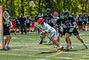 Baldwinsville Bees Keegan Lynch (13) leaning in against Marcellus Mustangs Ryan Moses (13) in Section III Boys Lacrosse action at the Pelcher-Arcaro Stadium in Baldwinsville, New York on Saturday, May 15, 2021. Baldwinsville won 17-4.