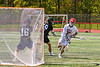 Baldwinsville Bees Ryan Hollenbeck (17) pops the net behind Marcellus Mustangs goalie Quenten Polkowski (16) for a goal in Section III Boys Lacrosse action at the Pelcher-Arcaro Stadium in Baldwinsville, New York on Saturday, May 15, 2021. Baldwinsville won 17-4.