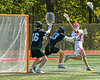 Baldwinsville Bees Keegan Lynch (13) gets shot off against Marcellus Mustangs Marcus Darminio (23) and goalie Quenten Polkowski (16) in Section III Boys Lacrosse action at the Pelcher-Arcaro Stadium in Baldwinsville, New York on Saturday, May 15, 2021. Baldwinsville won 17-4.