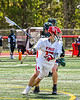 Baldwinsville Bees Ryan Hollenbeck (17) avoiding  Marcellus Mustangs defenders with the ball in Section III Boys Lacrosse action at the Pelcher-Arcaro Stadium in Baldwinsville, New York on Saturday, May 15, 2021. Baldwinsville won 17-4.