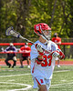 Baldwinsville Bees Trey Ordway (33) looking to make a pass against the Marcellus Mustangs in Section III Boys Lacrosse action at the Pelcher-Arcaro Stadium in Baldwinsville, New York on Saturday, May 15, 2021. Baldwinsville won 17-4.