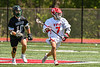 Baldwinsville Bees Jacob Czyz (7) running with the ball after winning a face-off against Marcellus Mustangs Matt Welch (10) in Section III Boys Lacrosse action at the Pelcher-Arcaro Stadium in Baldwinsville, New York on Saturday, May 15, 2021. Baldwinsville won 17-4.