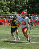 Baldwinsville Bees Trey Ordway (33) proteching the ball from West Genesee Wildcats Ryan Mahoney (30) in Section III Class A Finals Boys Lacrosse action at Pelcher-Arcaro Stadium in Baldwinsville, New York on Saturday, May 12, 2021. Baldwinsville won 14-7.