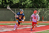 Baldwinsville Bees Ryan Hollenbeck (17) checking West Genesee Wildcats Sam Rosa (31) in Section III Class A Finals Boys Lacrosse action at Pelcher-Arcaro Stadium in Baldwinsville, New York on Saturday, May 12, 2021. Baldwinsville won 14-7.