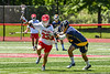 Baldwinsville Bees Trey Ordway (33) protecting the ball from West Genesee Wildcats Nicholas Louise (5) in Section III Class A Finals Boys Lacrosse action at Pelcher-Arcaro Stadium in Baldwinsville, New York on Saturday, May 12, 2021. Baldwinsville won 14-7.