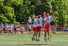 Baldwinsville Bees goalie Cooper Foote (5), Austin McClintic (8), Tucker Macknik (14) and Jack Prossner (10) celebrate the win over the West Genesee Wildcats in the Section III Class A Finals Boys Lacrosse game at Pelcher-Arcaro Stadium in Baldwinsville, New York on Saturday, May 12, 2021. Baldwinsville won 14-7.