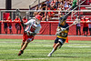 Baldwinsville Bees Lucas Hoskin (16) protecting the ball from a West Genesee Wildcats defender in Section III Class A Finals Boys Lacrosse action at Pelcher-Arcaro Stadium in Baldwinsville, New York on Saturday, May 12, 2021. Baldwinsville won 14-7.