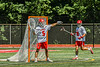 Baldwinsville Bees goalie Cooper Foote (5) directing his defense against the West Genesee Wildcats in Section III Class A Finals Boys Lacrosse action at Pelcher-Arcaro Stadium in Baldwinsville, New York on Saturday, May 12, 2021. Baldwinsville won 14-7.