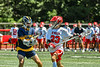 Baldwinsville Bees Colin Doyle (23) with the ball against  West Genesee Wildcats Braeden McNeill (29) in Section III Class A Finals Boys Lacrosse action at Pelcher-Arcaro Stadium in Baldwinsville, New York on Saturday, May 12, 2021. Baldwinsville won 14-7.