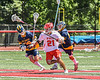 Baldwinsville Bees Brayden Penafeather-Stevenson (21) with the ball against the West Genesee Wildcats in Section III Class A Finals Boys Lacrosse action at Pelcher-Arcaro Stadium in Baldwinsville, New York on Saturday, May 12, 2021. Baldwinsville won 14-7.