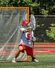 Baldwinsville Bees goalie Cooper Foote (5) makes a save against the West Genesee Wildcats in Section III Class A Finals Boys Lacrosse action at Pelcher-Arcaro Stadium in Baldwinsville, New York on Saturday, May 12, 2021. Baldwinsville won 14-7.