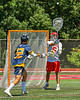 Baldwinsville Bees goalie Cooper Foote (5) passing the ball against the West Genesee Wildcats in Section III Class A Finals Boys Lacrosse action at Pelcher-Arcaro Stadium in Baldwinsville, New York on Saturday, May 12, 2021. Baldwinsville won 14-7.