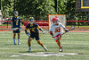 Baldwinsville Bees Trey Ordway (33) with the ball against West Genesee Wildcats Patrick Linton (7) in Section III Class A Finals Boys Lacrosse action at Pelcher-Arcaro Stadium in Baldwinsville, New York on Saturday, May 12, 2021. Baldwinsville won 14-7.