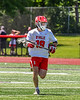 Baldwinsville Bees John Morrissey (18) running with the ball against the West Genesee Wildcats in Section III Class A Finals Boys Lacrosse action at Pelcher-Arcaro Stadium in Baldwinsville, New York on Saturday, May 12, 2021. Baldwinsville won 14-7.