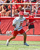Baldwinsville Bees Brayden Penafeather-Stevenson (21) running the ball against the West Genesee Wildcats in Section III Class A Finals Boys Lacrosse action at Pelcher-Arcaro Stadium in Baldwinsville, New York on Saturday, May 12, 2021. Baldwinsville won 14-7.