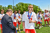 Baldwinsville Bees Rory Mastine (11) receiving his NYSPHSAA Section III Class A Boys Lacrosse championship medal at the Pelcher-Arcaro Stadium in Baldwinsville, New York on Saturday, June 12, 2021.