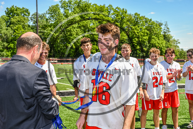 Baldwinsville Bees Lucas Hoskin (16) receiving his NYSPHSAA Section III Class A Boys Lacrosse championship medal at the Pelcher-Arcaro Stadium in Baldwinsville, New York on Saturday, June 12, 2021.